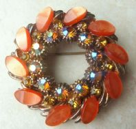 Vintage Large Aurora Borealis And Peach Lucite Garland Brooch.